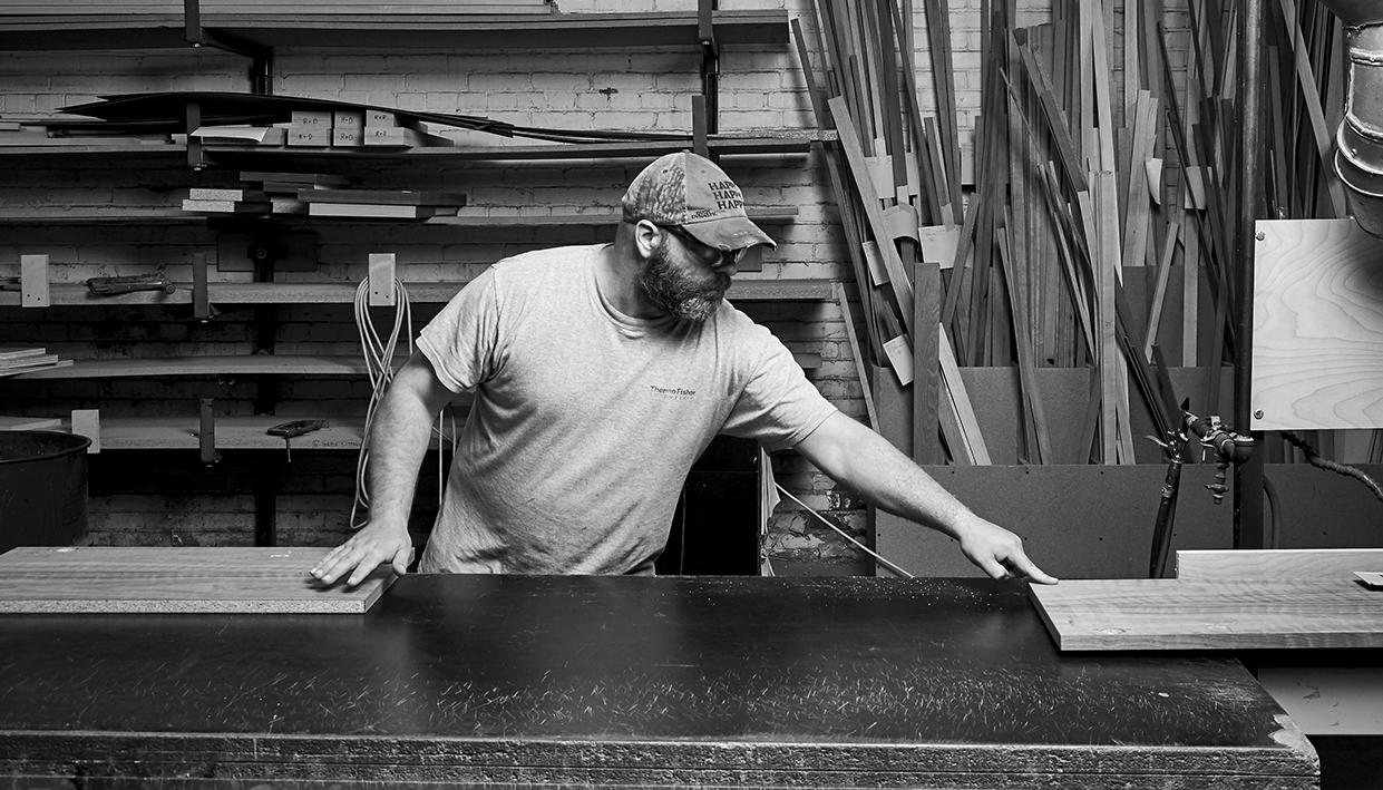 Kraig, Woodworking Associate | A sensitive guy, he can tell with one touch when the job is done right.